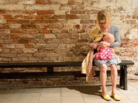 mother nursing toddler